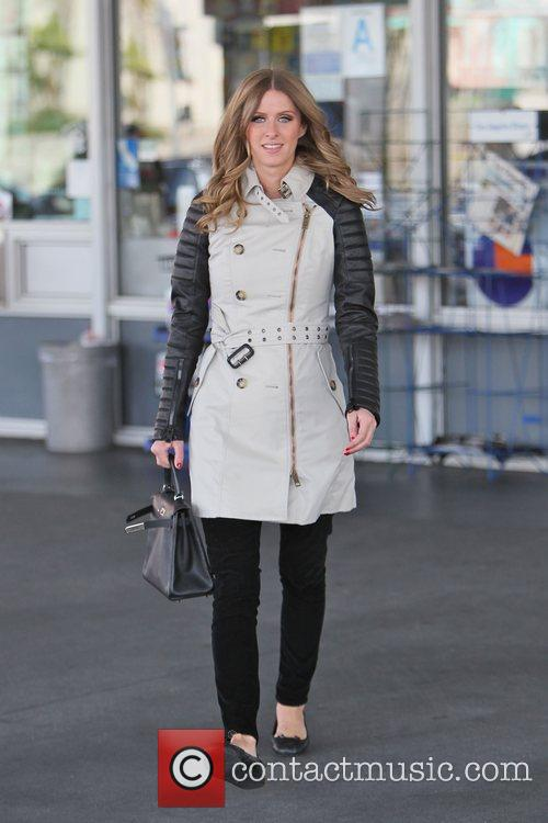 Nicky Hilton wearing a leather trench coat with...