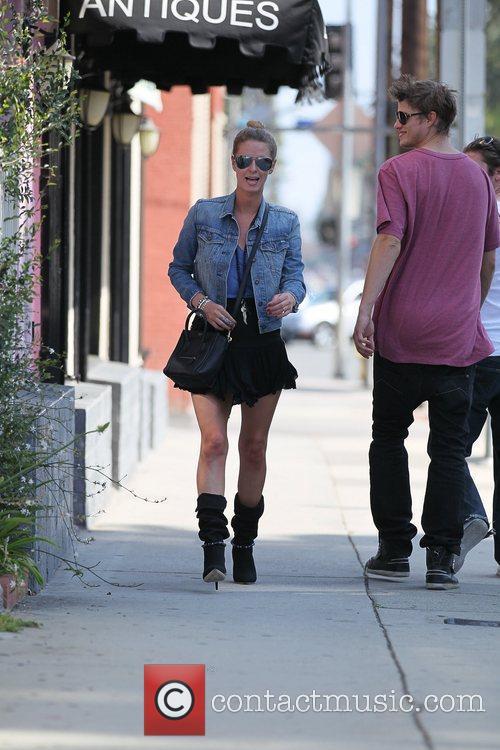 Nicky Hilton  carries a handful of dirty...