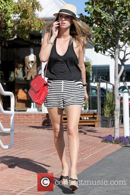 Nicky Hilton talking on her cell phone as...