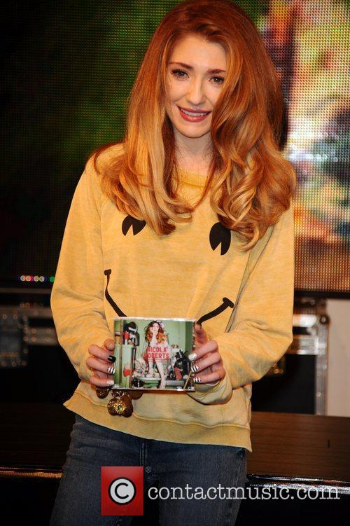 Nicola Roberts meets fans and signs copies of...