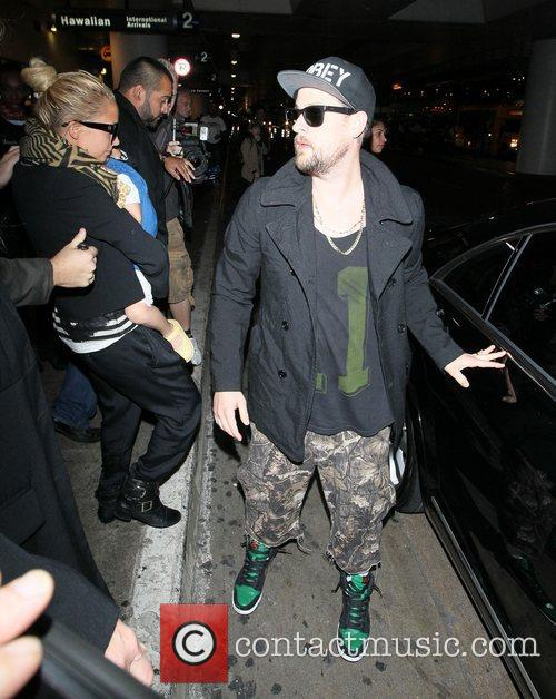 Joel Madden and Nicole Richie arrive at LAX...
