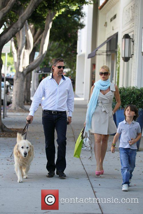 Nicollette Sheridan and her boyfriend, Steven Pate, stroll...