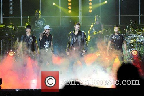 Nick Carter, A.J. McLean, Brian Littrell, and Howie...