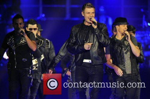 Performing live in concert on the NKOTBSB Tour...