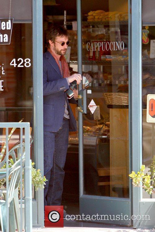 Noah Wyle carrying books and his iPad after...