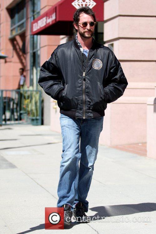 Wearing a bomber jacket as he runs errands...