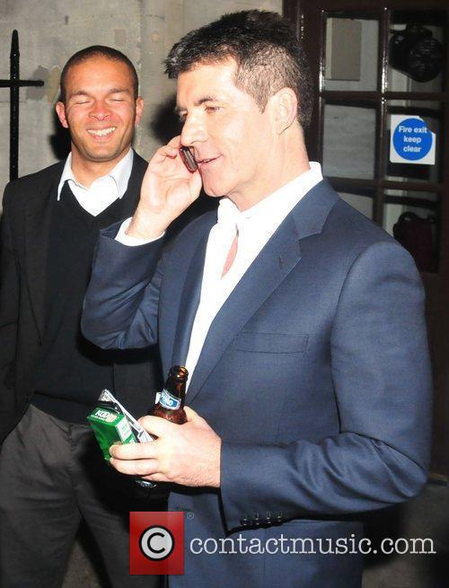 Simon Cowell on his mobile phone,  at...
