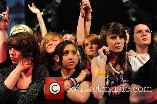 Fans watching Of Mice and Men at the...