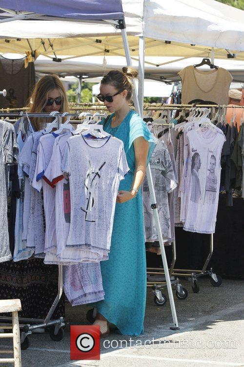 Olivia Wilde and a friend browse around a...