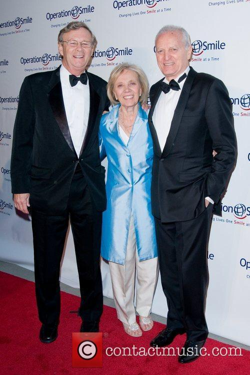 Bill Magee, Kathy Magee, Santo Versace  The...