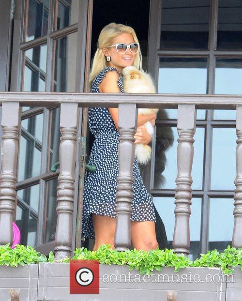 Paris Hilton brings her pet dog out on...