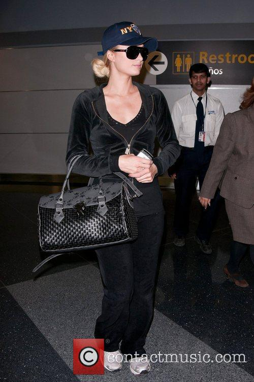 Paris Hilton leaves JFK Airport for LAX in...