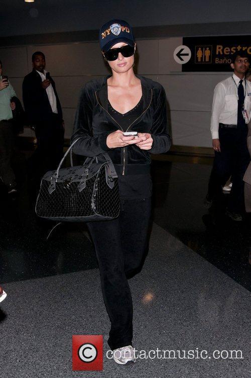 Paris Hilton - Paris Hilton leaves JFK Airport for LAX in a NYPD ... 681fe8cd1cc2