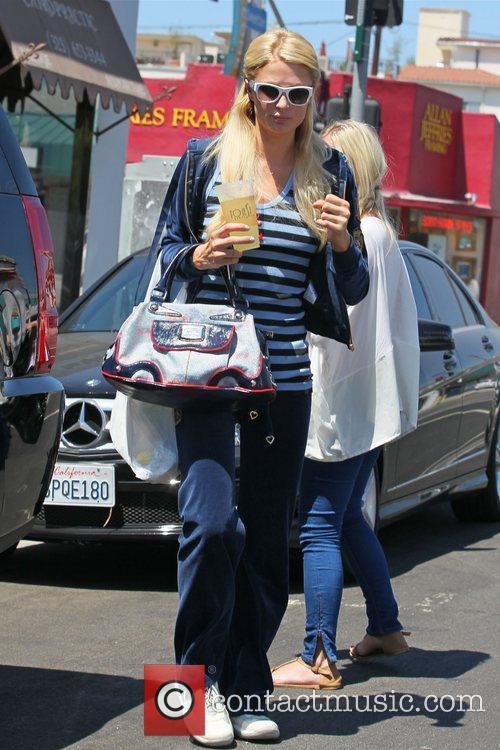 Paris Hilton is seen carrying a fruit juice...