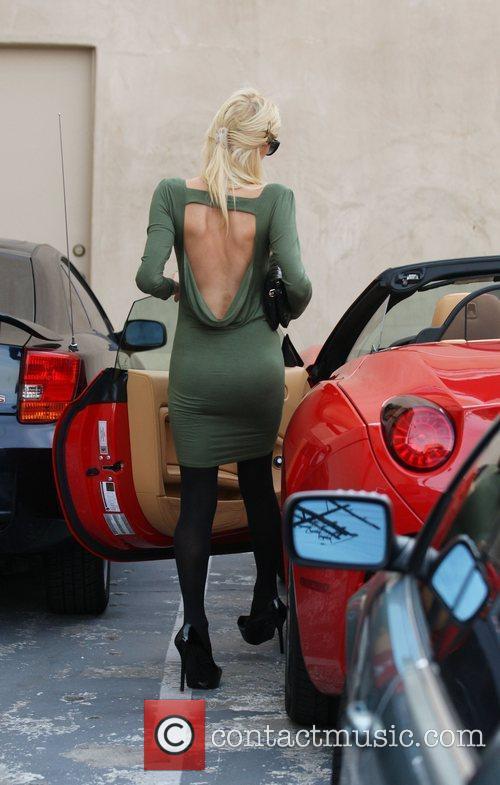 Paris Hilton arrives in a parking lot in...