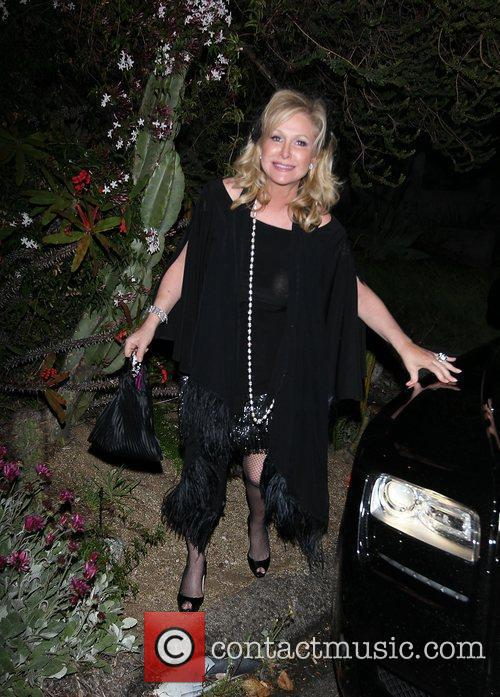 Arrives at a private residence in Hollywood for...