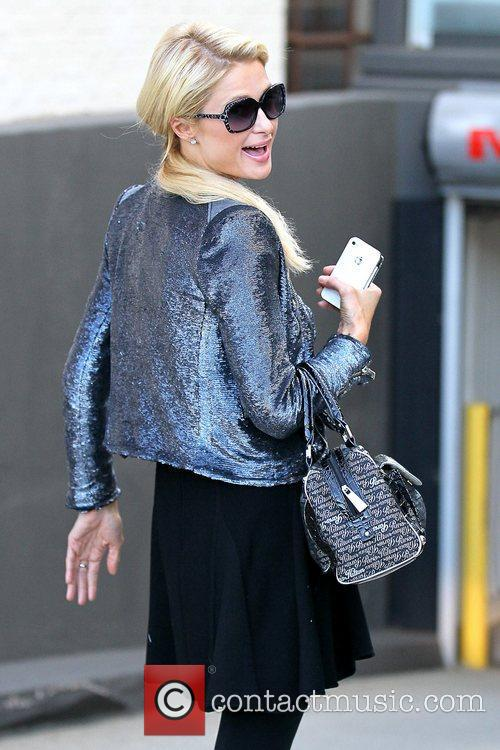 Paris Hilton in good spirits as she runs...