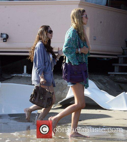 Paris Hilton flocks from her beach tent as...