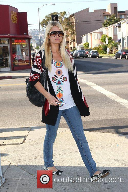 Paris Hilton wearing a colourful outfit as she...
