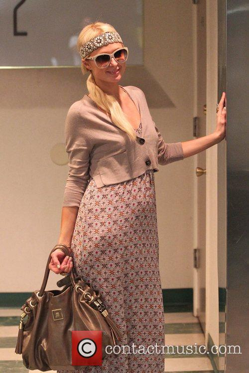 Paris Hilton shopping in Beverly Hills wearing a...