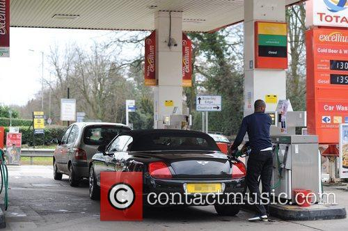 Patrick Vieira fills his Bentley with petrol at...