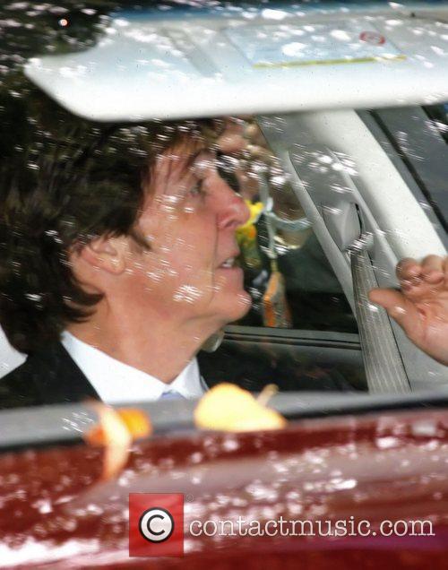 Sir Paul McCartney  leaving his house and...