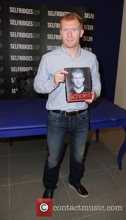 Manchester United's midfielder Paul Scholes at his book...