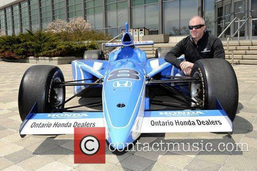 Race car driver Paul Tracy promotes his partnership...