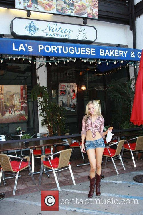 Sticks to her Portuguese roots while out and...