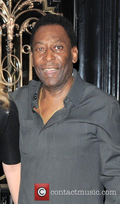 Former Brazilian football player, Pele, leaving Scotts restaurant...