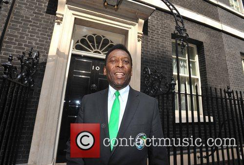 Arrives at Downing Street to play a game...