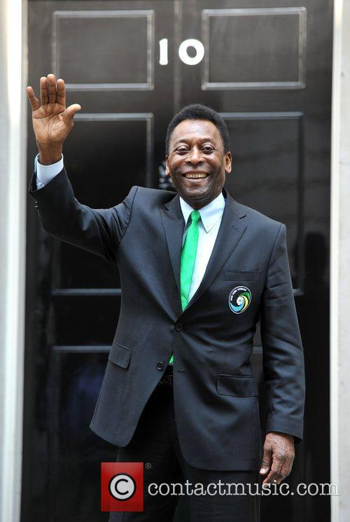 Pele arrives at Downing Street to play a...