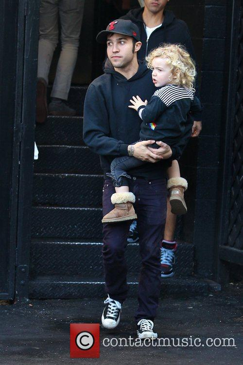 Pete Wentz carrying his son as they leave...
