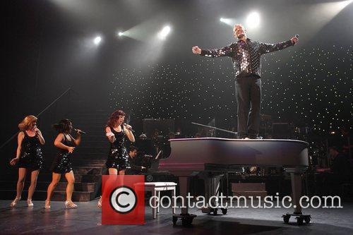 Todd McKenney, in the role of Peter Allen,...