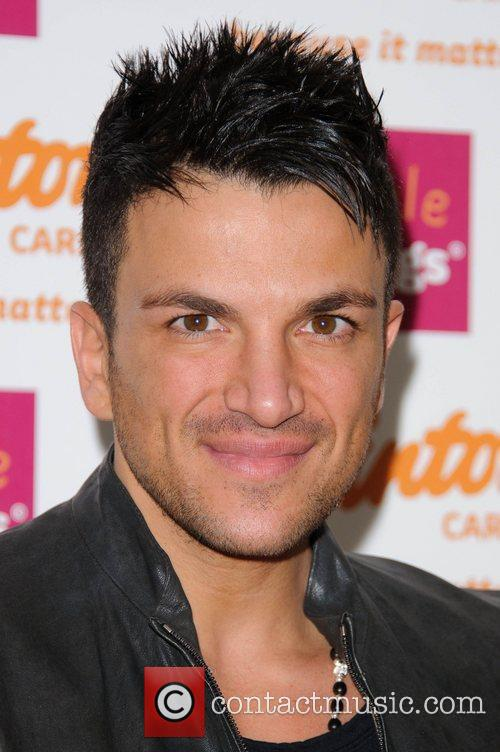 Peter Andre signs copies of his new 2011...