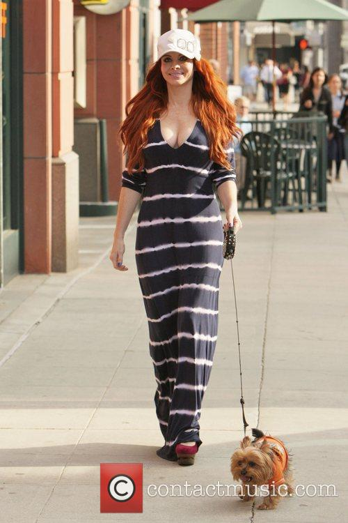 Phoebe Price seen walking her dog Henry in...