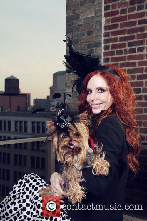 Phoebe Price holds her dog Henry during a...