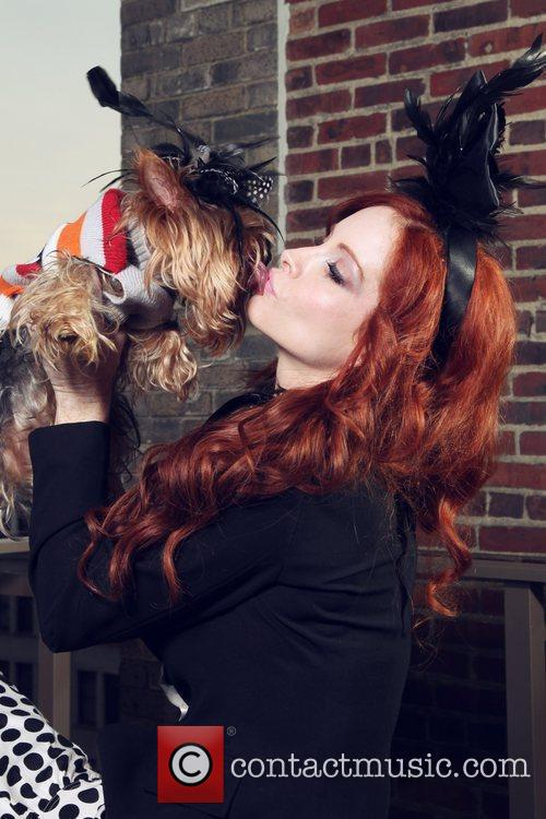 Phoebe Price kisses her dog Henry during a...