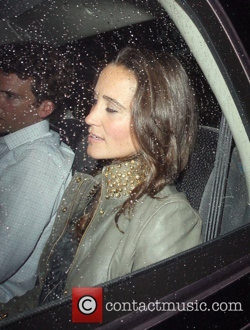 Leaving Public nightclub, where she exited via the...