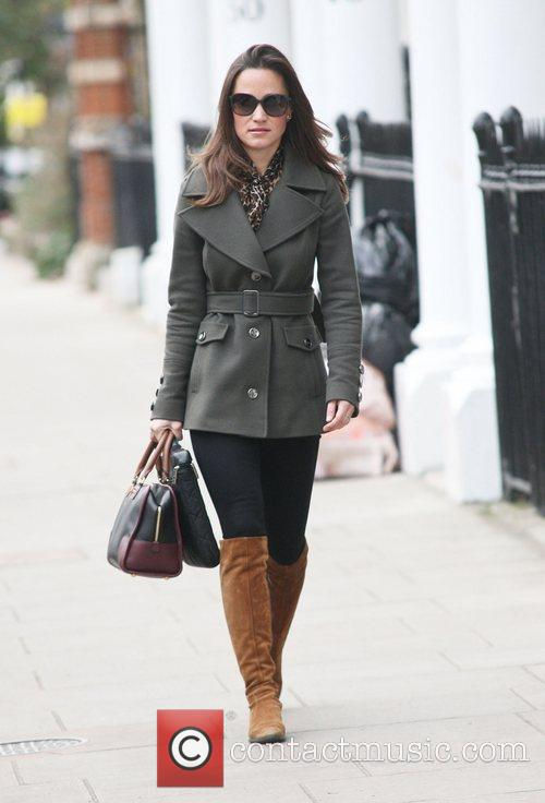 Pippa Middleton makes her way to work...