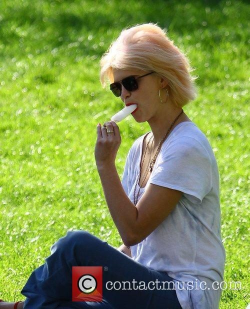 Pixie Geldof  enjoying an ice lolly, while...