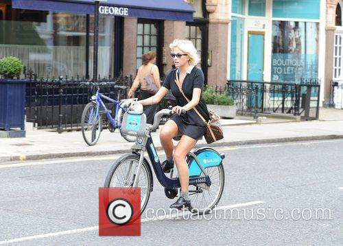 Spotted cycling on a 'Barclays Cycle Hire' bicycle