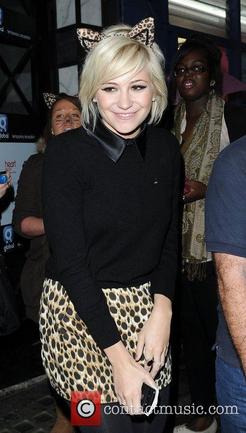 Pixie Lott leaves Capital Radio wearing leopard patterned...