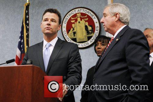 Deputy District Attorney David Walgren, left, makes a...