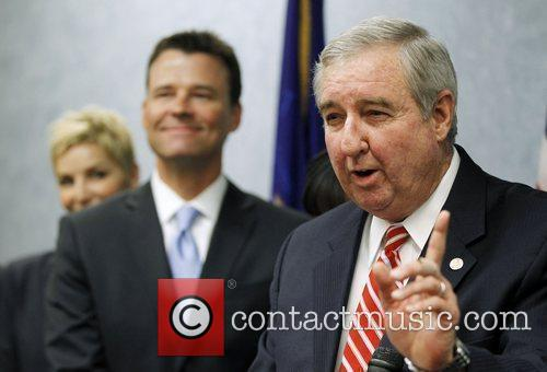 District Attorney Steve Cooley, right, answers a question...