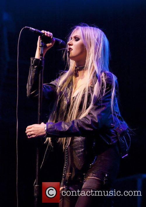 Taylor Momsen with the band Pretty Reckless performing...