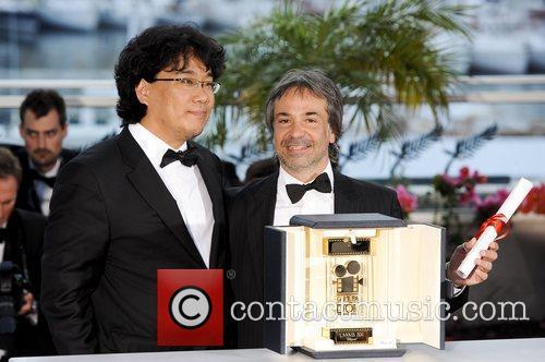 Director Michel Hazanavicius (L), Berenice Bejo (C) and...