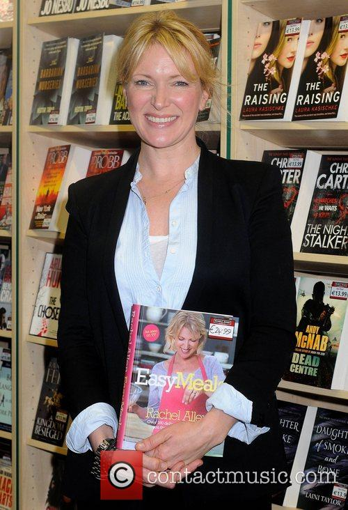 Signs copies of her new book 'Easy Meals'...