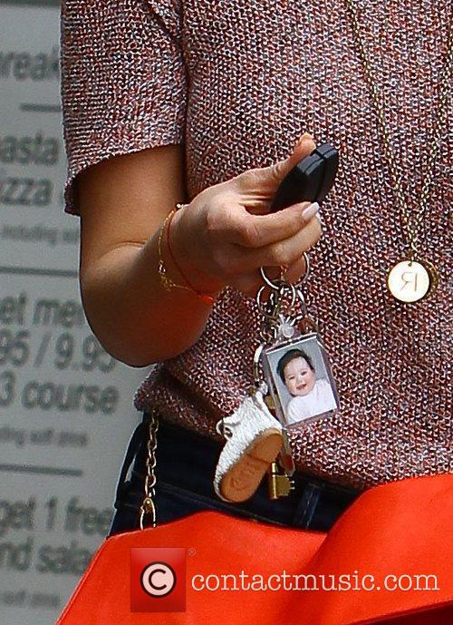Rachel Stevens showing off a keyring with a...
