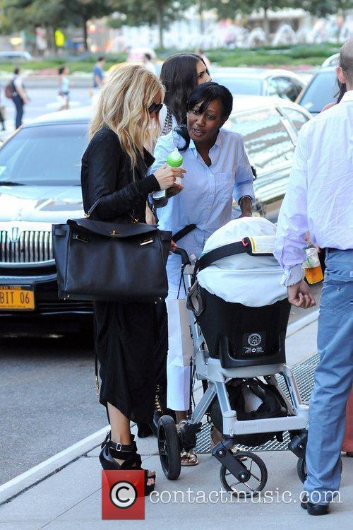 Arrives at her Manhattan Hotel with her son